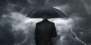8273-trial_trouble_dark_clouds_umbrella_man.630w.tn